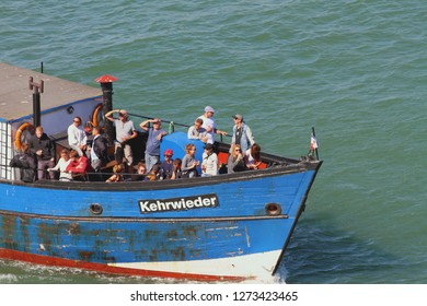 Warnemunde, Rostock, Germany - Jul 06, 2018: Passengers on fore of small vessel