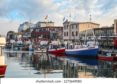 Warnemunde, Rostock Germany - September 4 2018: Shops and cafes line the Alter Strom canal at the cruise port in the resort town of Warnemunde, near Rostock on the northern coast of Germany.