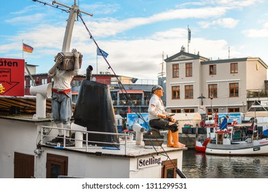 Warnemunde Rostock, Germany - September 4 2018: Two pirate figures rest on the deck of a tourist boat in the Alter Strom Canal in the Baltic Sea port city of Warnemunde, Germany.