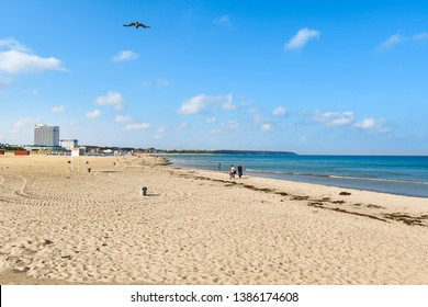 Warnemunde Rostock, Germany - September 4 2018: The wide, sandy beach along the Baltic Sea at the seaside town of Warnemunde Germany.