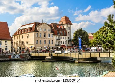 Warnemunde Rostock, Germany - September 5 2018: Tourists cross the bridge over the Alter Strom canal in the picturesque coastal town of Warnemunde, Germany.