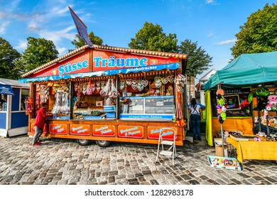 Warnemunde Rostock, Germany - September 5 2018: A customer orders from a colorful street vendor on the strand boardwalk waterfront promenade at Warnemunde, Germany.