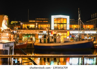 Warnemunde Rostock, Germany - September 5 2018: Tourists and local Germans party and dine at the shops and cafes that line the Alter Strom Canal late night in Warnemunde, Germany.