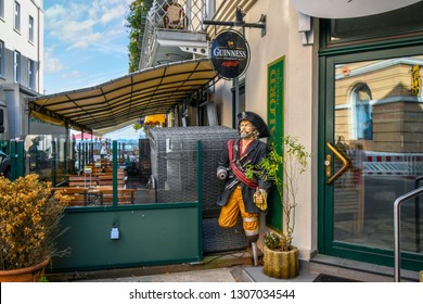 Warnemunde, Rostock Germany - September 6 2018: A pirate figure with a peg leg and claw hand stands outside a bar in the coastal resort town of Warnemunde, Germany.