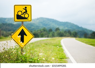 Warning bicycle road signs uphill with bicycle lane on the hill with copy space.