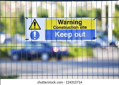 Warning, construction site. Keep Out sign on site fence.