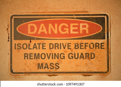Warning dangerous isolated drive equipment before removing guard mass sign at industrial construction mine site Pilbara region, Perth, Australia