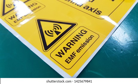 Warning EMF Symbol Sign,Radiation warning sign on the Hazardous materials transport label Class 7 at the aluminum container of transport truck