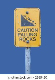 warning falling rocks sign isolated on blue