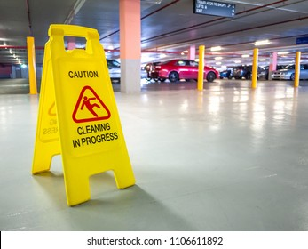 Warning janitorial sign of cleaning in progress in car park to warn passersby for safety.