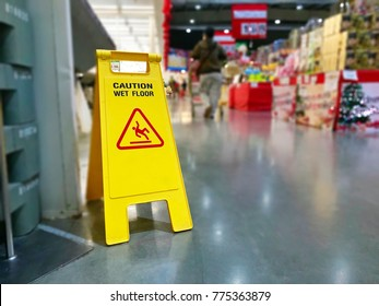 Warning label caution wet floor in the mall