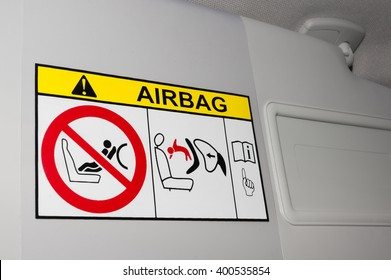 Warning label image and disabling key education airbag on the passenger side for transporting children