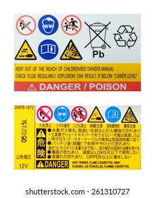 Warning label on car battery in English and Japanese language