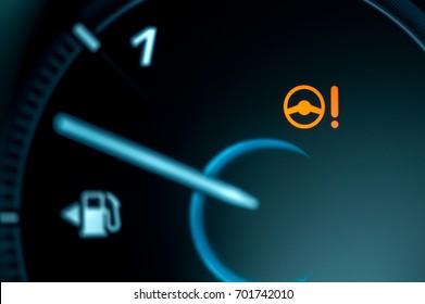 Warning light icon in car dashboard. Power steering failure