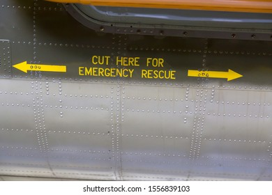 Warning message on the side of a military aircraft. Many rivets hold the metal plates together.