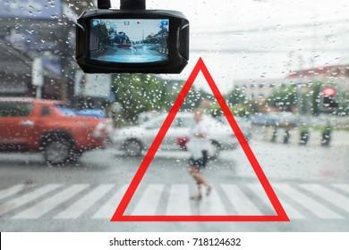 Warning ,pedestrian running cut the car off in the rain