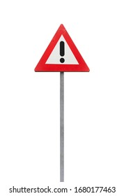 Warning road sign with black exclamation mark in red triangle isolated on white background