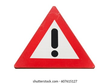 Warning road sign with black exclamation mark in red triangle isolated on white background, close up photo