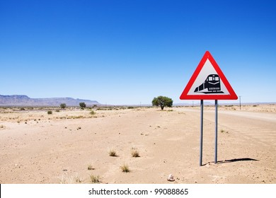Warning of road sign - train crossing the road, Namibia