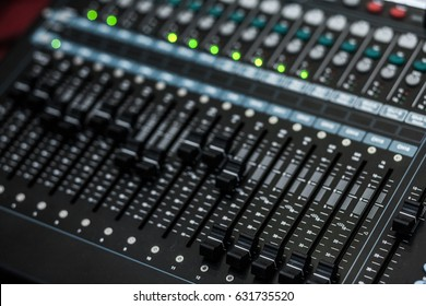 """WARNING SHALLOW DEPTH OF FIELD audio, a mixing console is an electronic device for combining (also called """"mixing""""), routing, and changing the volume level, timbre (tone color)"""