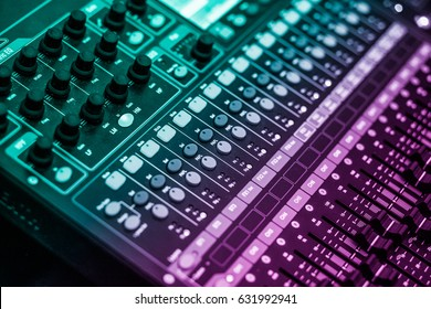 """WARNING SHALLOW DEPTH OF FIELD. SMALL APERTURE EFFECT audio a mixing console is an electronic device for combining (also called """"mixing""""), routing, and changing the volume level, timbre (tone color)"""
