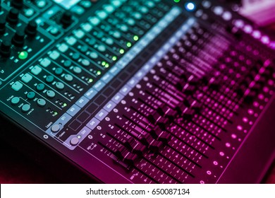 WARNING: SHALLOW DEPTH OF FIELD (small aperture effect) audio a mixing console is an electronic device for combining, routing, and changing the volume level, timbre (tone color)