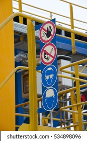 A warning sign about the danger. Safety in manufacturing