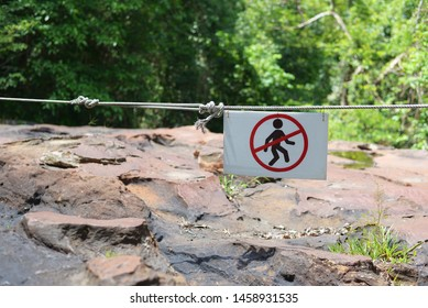 Warning sign do not climb over line,Cliff danger area.