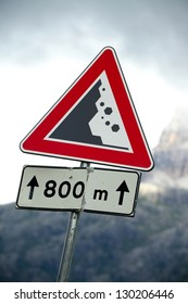 Warning sign of falling rocks on a mountain road
