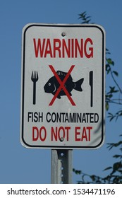 Warning sign: Fish a, Do not eat