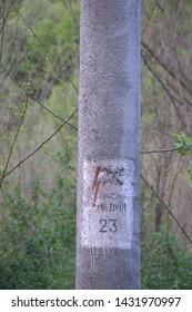 Warning Sign For High Voltage On The Concrete Pole For Transmission Of Electricity