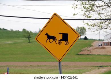 """warning sign """"horse drawn amish buggies"""""""