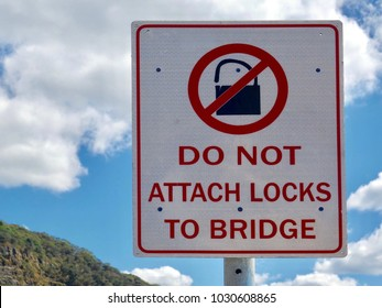 A warning sign informing people not to attach padlocks to a road bridge on the South Coast of New South Wales, Australia