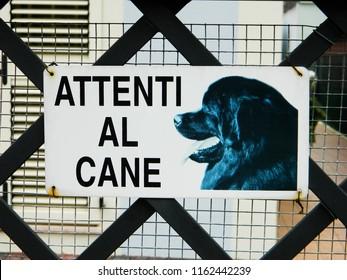 Warning sign in Italian - Dangerous dog. Warning.