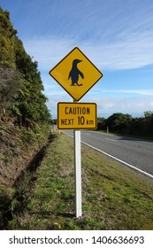 Warning sign in New Zealand: Caution, Pinguins ahead. On a windy road at the west coast of the South Island.