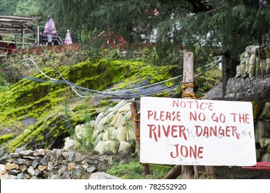 Warning Sign Next to Dangerous River in Kasol, India