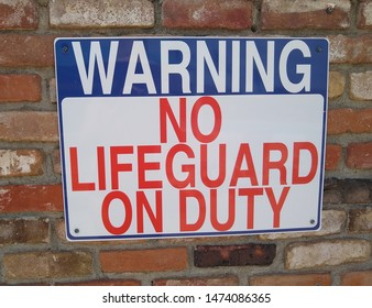 Warning sign no lifeguard on duty