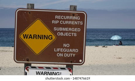 Warning sign on the beach - strong currents, no lifeguard