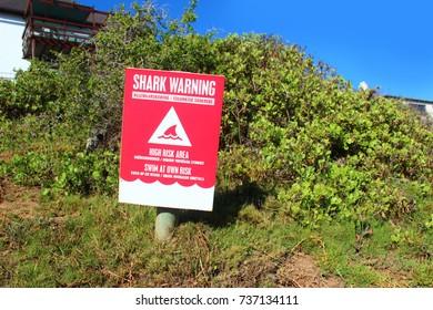 Warning sign on the beach walkway