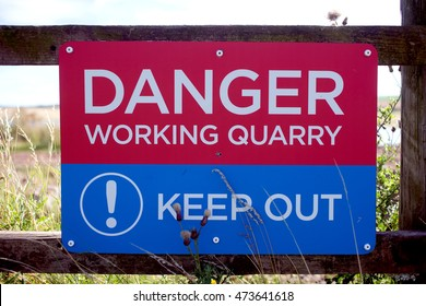 A warning sign on the fence surrounding the north-west quarry (Whitesands quarry) at Tarmac's Dunbar works, East Lothian, Scotland, United Kingdom on 24th August 2016.