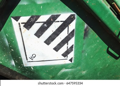 Warning sign on green cargo container. Hazard class 9. Miscellaneous dangerous substances