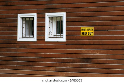 warning sign on a wooden wall