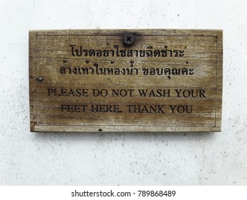 Warning sign in public restroom in Thailand