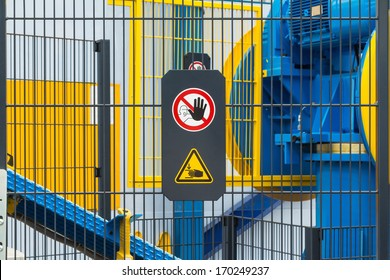 Warning sign for safety on machine, no entry and be careful of hand