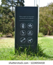 Warning Sign at Sculpture Park: do not touch, do not use bbq, no alcohol, no swimming, no bird and duck feeding, and dog must be on leash sign