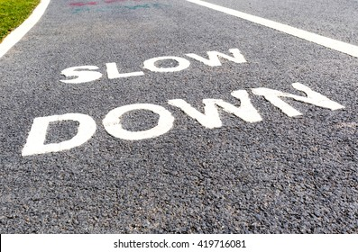 The warning sign to slow down marked on street, safety concept.