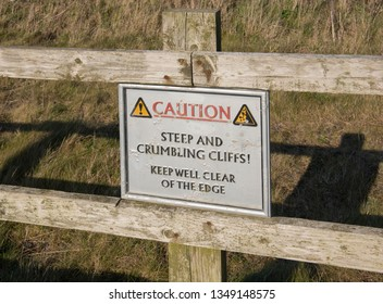 Warning Sign For Steep and Dangerous Cliffs on the South West Coast Path between Portreath and Hayle in Rural Cornwall, England, UK