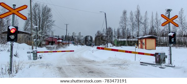 Warning signals in a railroad crossing in a snowy road