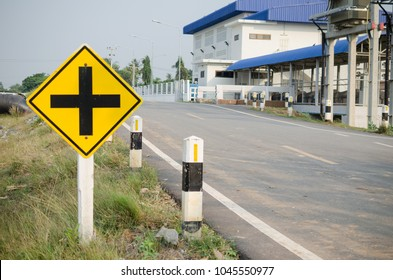 warning sign,intersection ahead traffic sign on roadside.crossroads.Paved road in countryside Thailand.