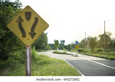 The warning signs ahead are the middle of the road.